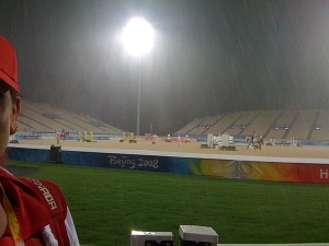 the main competition arena under the lights and the rain.....our Canadian eventers in the background