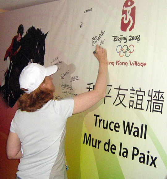 Olympic dressage rider Leslie Reid leaves her signature on the wall