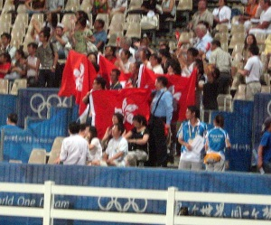some more Hong Kong fans. When Patrick Lam clinched a clear round, the place erupted in deafening cheers and applause. It was quite something! Patrick was so excited that he threw his helmet up into the air and was doing some major fist-pumping in celebration.