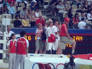 Team Canada on the podium to watch Ian Millar's round with In Style